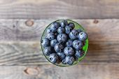 Fresh Blueberries In Glass Bowl. Fresh Wet Berries On Rustic Wooden Background. Fresh-gathered Berri poster