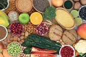 Health food for a high fibre diet with fruit, vegetables, whole grain bread rolls, grains, whole whe poster