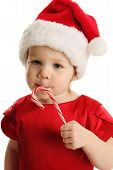 Close Up Of Little Girl Licking A Candy Cane