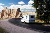 stock photo of motor coach  - vacationing in a recreational vehicle in the badlands national park - JPG