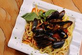 Seafood Mussels In Red Sauce Over Pasta