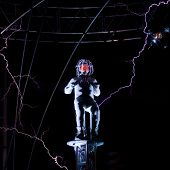 NEW YORK - OCT 6: Endurance artist David Blaine is struck by a spark of electric current from a Tesl