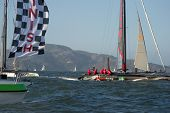 SAN FRANCISCO, CA - OCTOBER 4: Artemis Racing Red skippered by Nathan Outteridge crosses the finish