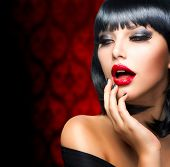 Beautiful Brunette Girl Portrait.Makeup. Sensual Red Lips and Smokey Eyes Make-up