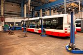 PRAGUE, CZECH REPUBLIC - SEPTEMBER 17: Inspection of chassis of public buses in workshop in Depot Ho