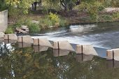 small dam diverting water for farmland irrigation - Cache la Poudre River above Greeley in northern
