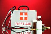 First aid box, on red background