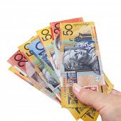 Handful of Australian money, isolated over white,