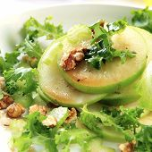Waldorf salad.  Apples, walnuts, celery and curly lettuce.