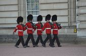The Queens Guards Keep Guard Inside The Grounds Of Buckingham Palace, In London 22Nd July 2013