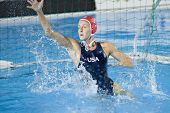 Jul 29 2009; Rome Italy;  USA team goalkeeper Elizabeth Armstrong saves a shot in the waterpolo match between USA and Greece, USA won the match 8-7, at the 13th Fina World Aquatics Championships
