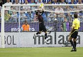 MALAGA, SPAIN. 19/09/2010. Sevilla's goalkeeper Andr�?�?�?�©s Palop (captain) makes a save duri