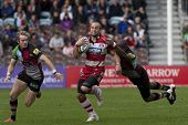 17/09/2011. Twickenham, England.  Gloucester's Charlie Sharples,  is tackled by Harlequins Ugo Monye