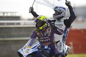 27 Sept 2009; Silverstone England: Rider number 2 Leon Camier (GBR) gets a lift back to the pits aft
