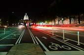 Washington DC, United States Capitol building night view from from Pennsylvania Avenue with car ligh