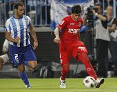 MALAGA, SPAIN. 19/09/2010. Jesus G�?�?�?�¡mez the Malaga defender and Diego Perotti a Sevilla midfield player  during the La Liga match between CF Malaga and Sevilla, played in the La Rosaleda Stadium