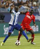 MALAGA, SPAIN. 19/09/2010. Quincy Owusu-Abeyie the Malaga forward shields the ball from Didier Zokora a Sevilla midfield player during the La Liga match between CF Malaga and Sevilla