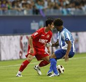 MALAGA, SPAIN. 19/09/2010. Alejandro Alfaro a Sevilla midfield player and Eliseu  Malaga midfielder