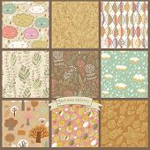 Set of eight autumn seamless patterns with rain clouds, leafs, flowers, trees. Cute vector backgrounds in warm retro colors. Seamless pattern can be used for wallpaper, pattern fills, surface textures