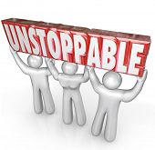 A team of three people lifts the word Unstoppable to illustrate the concept of determination and wor