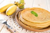 Banana pancakes or crepe on dining table.