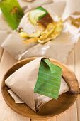 Nasi lemak - traditional Malaysian breakfast on banana leaf