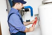 Plumber repairing a hot water heater