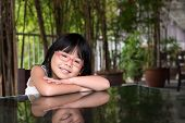 stock photo of taoism  - Portrait of little Asian girl with glasses - JPG