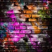 stock photo of messy  - graffiti brick wall - JPG