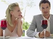 Beautiful young woman admiring man at dinner table