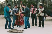 Madrid - January 25: Band Of Streets Musicians Playing In Retiro Park On January 25, 2014 In Madrid,
