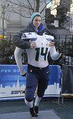 Unidentified Seattle Seahawks fan taken photo with Seahawks team uniform on Broadway