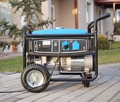 picture of generator  - Gasoline powered portable generator at home  - JPG