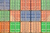 background of freight shipping containers at the docks
