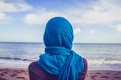 picture of middle eastern culture  - Rear View Of Woman With Headscarf Looking At The Sea - JPG