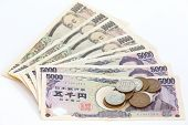foto of yen  - close up Japanese currency notes and japanese yen coin - JPG