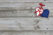 Red, white and blue hearts hanging on wood background