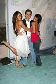 HOLLYWOOD - APRIL 21: Carrie Ann Inaba with Louis Van Amstel and Cheryl Burke at the opening of Leeza's Place Care Center at Leeza's Place Care Center on April 21, 2006 in Hollywood, CA.