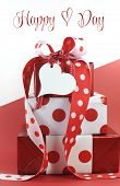 Polka Dot Decorated Gifts On Red And White Background With Sample Text Or Copy Space For Valentine,