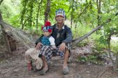 Man With Child Of Asia On Hammock, Akha