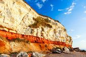 Red & White Chalk Cliff At Beach In Old Hunstanton, Norfolk, England