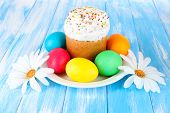 Sweet Easter cakes with colorful eggs on table close-up