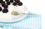Cheesecake with fresh berries on white plate closeup