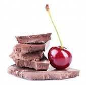 Cherry and chopped chocolate isolated on white