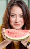 Young Asian Cute Woman And Eating Watermelon