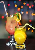 Assortment of tasty cocktails on bright background