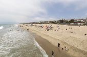 MANHATTAN BEACH, CALIFORNIA - July 15, 2014:  Summer beach goers and affluent homes in the town of M