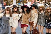 TOKYO,JAPAN, NOVEMBER 25, 2011 : A group of girls is posing in the middle of the street for fashion