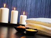 Spa Massage Border Background With Towel Stacked.candles And Sea Salt