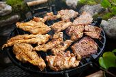 Steak And Chicken Meat Grilled On Barbecue